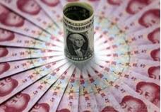 人民币对美元升突出6.5关口  去年底换的2万美元亏9000元人民币