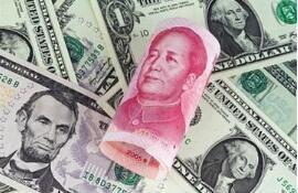 人民币兑美元中间价调升103个基点,报6.4009