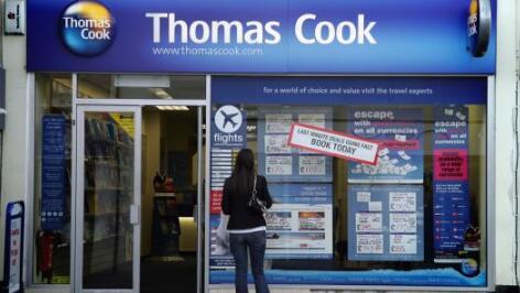 由于英国市场疲软,托马斯库克再次削减盈利预测
