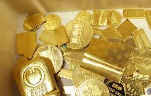 黄金期货价格周五收跌0.5%,收于1241.40美元/盎司