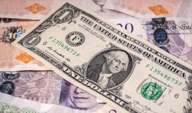 美元在温和的美联储押注中走弱,英镑走软