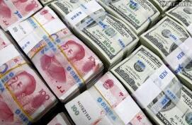 5月20日,人民币对美元中间价调贬129个基点,报6.8988