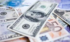 11月18日,人民币对美元中间价上调54个基点,报7.0037