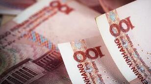 12月27日,人民币对美元报6.9879  中间价调贬78个基点