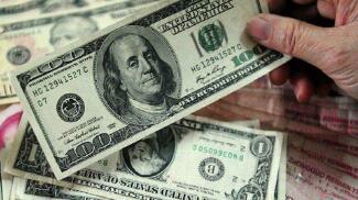 1月8日,人民币中间价报6.9450,上调240点