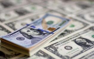 7月13日,人民币中间价报6.9965,下调22点