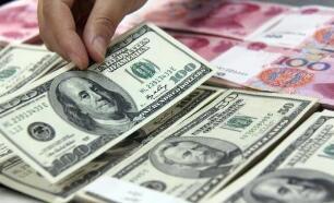 7月5日,人民币对美元中间价上调17点